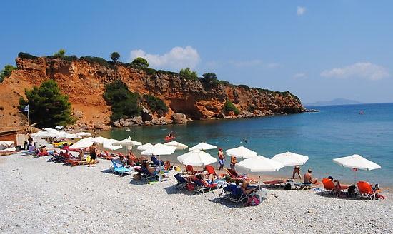 sun umbrellas in a row on the beach