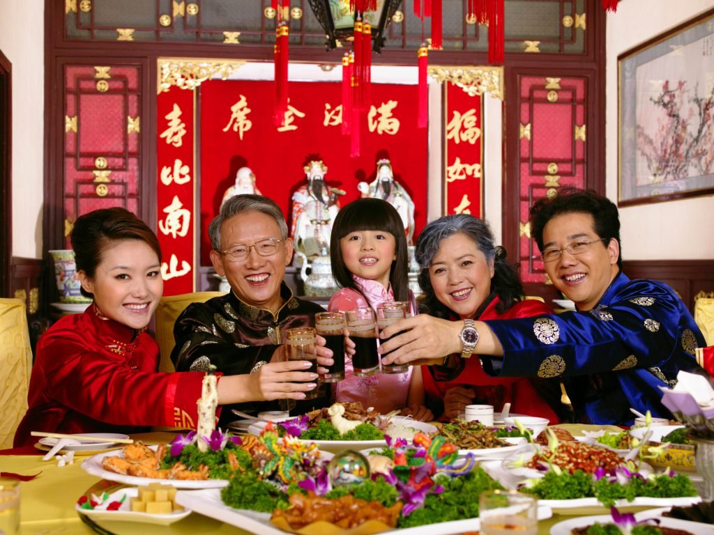Chinese family dining and toasting